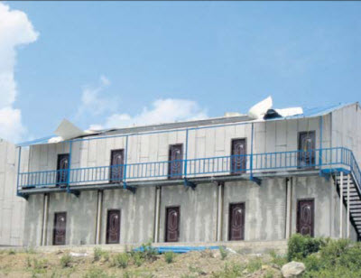This incomplete dorm building of University of St. Eustatius School of Medicine at Lampeweg is already in a serious state of disrepair. (Photo The Daily herald)